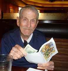 Dad holding cash on birthday
