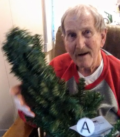 Dad with wee christmas tree 2018